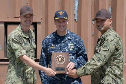 SAN DIEGO (June 30, 2017) Capt. Brian Davies, center, commanding officer of Commander, Submarine Squadron 11, presents Cmdr. Mark Hazenberg, commanding officer of Undersea Rescue Command and Master Chief Hospital Corpsman Francisco Lazarin, senior enlisted leader of URC with the Battle Effectiveness award on Naval Air Station North Island, June 30. The Battle Effectiveness award recognizes sustained superior performance in an operational environment. A command must achieve superior performance in certifications and qualifications within their organization. U.S. Navy photo by MC1 Derek Stroop
