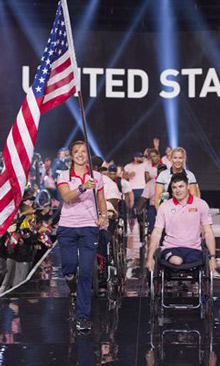 Air Force Capt. Christy Wise, U.S. team captain, carries the American flag as her team enters the opening ceremony for the 2017 Invictus Games at the Air Canada Centre in Toronto, Sept. 23, 2017. At right is team co-captain Marine Corps Sgt. Ivan Sears. The Invictus Games, established by Britain's Prince Harry in 2014, brings together wounded and injured veterans from 17 nations for 12 adaptive sporting events, including track and field, wheelchair basketball, wheelchair rugby, swimming, sitting volleyball and -- new to the 2017 games -- golf. DoD photo by Roger L. Wollenberg