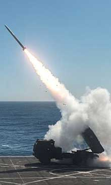 PACIFIC OCEAN (Oct. 22, 2017) The High Mobility Artillery Rocket System (HIMARS) is fired from the flight deck of the amphibious transport dock ship USS Anchorage (LPD 23) during Dawn Blitz 2017 over the Pacific Ocean, Oct. 22, 2017. Dawn Blitz is a scenario-driven exercise designed to train and integrate Navy and Marine Corps units by providing a robust training environment where forces plan and execute an amphibious assault, engage in live-fire events, and establish expeditionary advanced bases in a land and maritime threat environment to improve naval amphibious core competencies. U.S. Navy photo by MC2 Matthew Dickinson